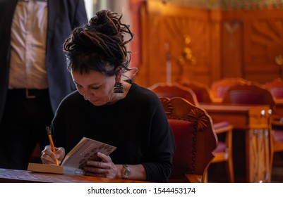 Cracow, Poland - October 27, 2019: Noble prize winner Olga Tokarczuk signs books during International Book Fair in Krakow in 2019