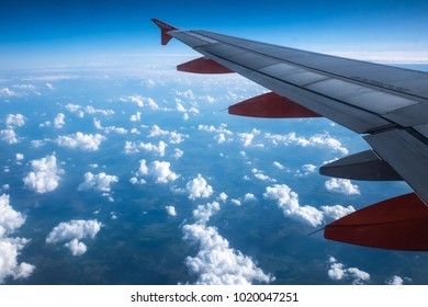 CRACOW, POLAND - September 23, 2017: A view of the clouds from the passenger airplane window during the flight over Poland.
