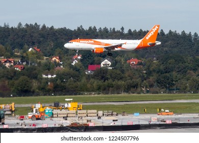 Cracow, Poland September 30 2018: EasyJet aircraft Airbus a320 is landing on the International Balice airport in Cracow, Poland