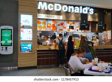 """Cracow/Krakow/Poland - 11 September 2018:  McDonald's at """"Galeria Krakowska"""" shopping mall. People buying fast-food from McDonald's Restaurant. Young people eating fast food"""