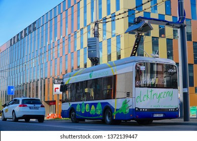 Cracow/Krakow/Poland - 16 April 2019: Electric bus, manufactured by the Polish company Solaris Bus & Coach, which actively enters the electro mobility market. The electric bus at the charging station.