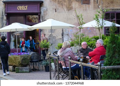 Cracow/Krakow/Poland - 16 April 2019: One of the most fashionable coffee bars in Cracow - Café Camelot. People at the garden cafe.