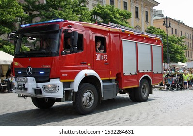 Cracow/Poland - June 07 2019: fire truck on a school children parade on the Main Market on a sunny summer day in Krakow.
