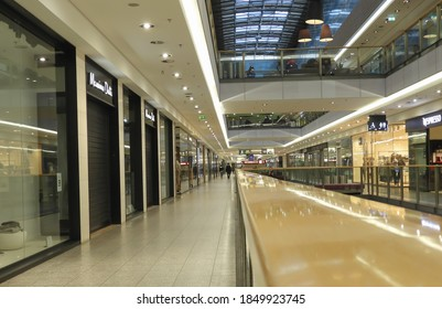 """Cracow/Poland - November 2020: A view on an empty passage in the shopping mall """"Galeria Krakowska"""" and closed stores caused by lockdown during pandemic of coronavirus. Selected focus."""