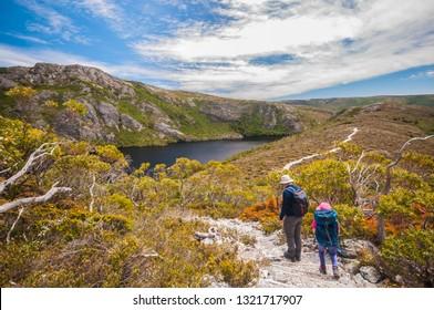 Cradle Mountain - December 25, People are trekking along bush walking and mountain climbing track over the crater lake on December 25, 2018 in Cradle Mountain, Tasmania, Australia