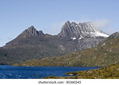 Cradle Mountain with a dusting of snow. Lake St Clair National Park, Tasmania, Australia.