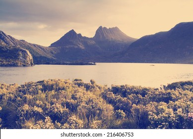 Cradle Mountain, an iconic Australian landscape in glowing sunset light with Instagram style filter