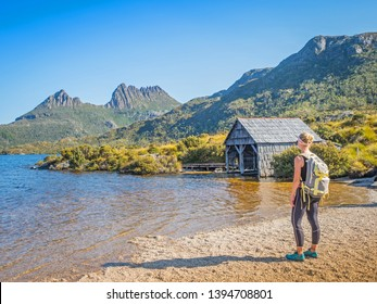 CRADLE MOUNTAIN - LAKE ST CLAIR NATIONAL PARK, AUSTRALIA - FEBRUARY 24, 2019: A hiker looks at the boathouse at Dove Lake in the Cradle Mountain - Lake St Clair National Park in Tasmania, Australia.