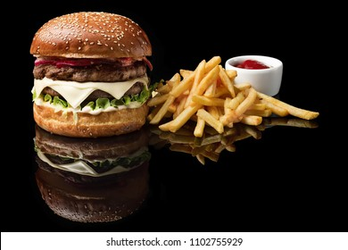 Craft beef burger and french fries, sauce isolated on black background. fast food