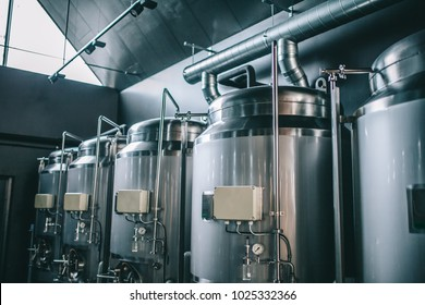 Craft beer brewing equipment in brewery! Metal tanks, alcoholic drink production