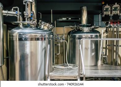 Craft beer brewing equipment in brewery! Metal tanks