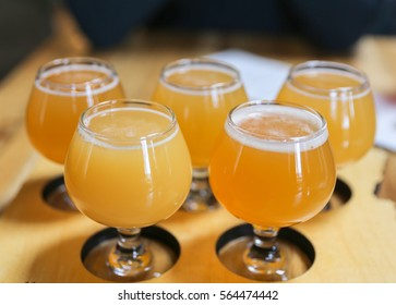Craft Beer Flight of Five Hazy Northeast Style IPA's Served in 5 ounce Tasting Glasses.  IPA's are the most popular and largest selling style of craft beer in the United States.