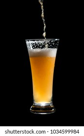 craft beer glass on black background