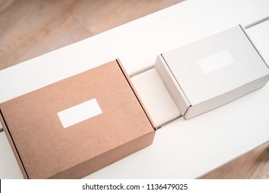 Craft boxes on white table from above. Product packaging, branding mockup, delivery service.