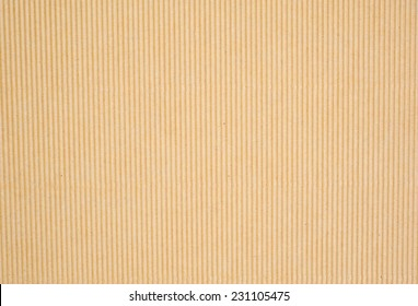 Craft eco textured ribbed paper sheet background.