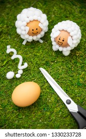 Craft ideas for the easter season, lamb shaped easter eggs and materials on green moss