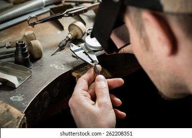 Craft jewelery making.  Measuring of the size of the diamond.