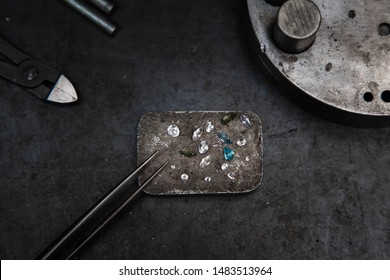 Craft jewelery making with professional tools. A handmade jeweler process, manufacture of jewellery. Working desk for craft jewelery making with professional tools.