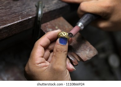 Craft jewelery making. Ring polishing.