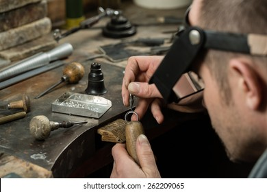 Craft jewelery making.  Ring repairing. Putting the diamond on the ring.