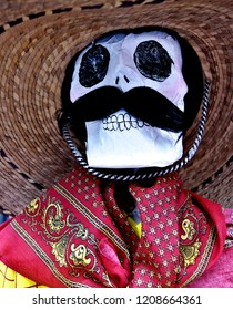Craft Mexican skull with mustache, sobrero and paliacate, All Saints Day Veracruz, Mexico 2017