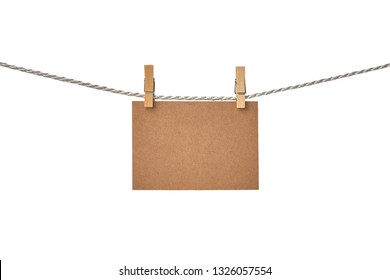 Craft paper blank card hanging on the clothesline isolated on white background