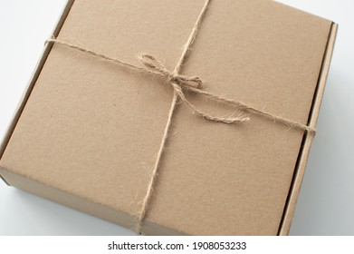 Craft paper box close up. Shipping eco package. Delivery pack. Gift idea, eco-lifestyle. Natural concept. Sustainable gift package.