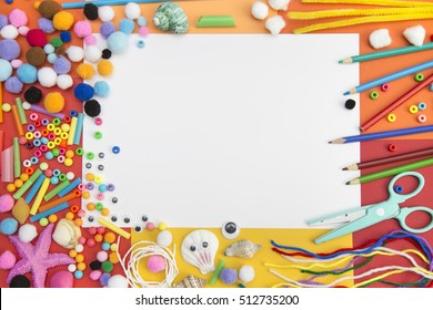 craft paper and materials used for kids crafts and art. Blank paper sheet in the middle for custom design or art displays