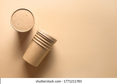 Craft paper soup cup on brown background. Empty container. Ecological individual package. Zero Waste. Top view.