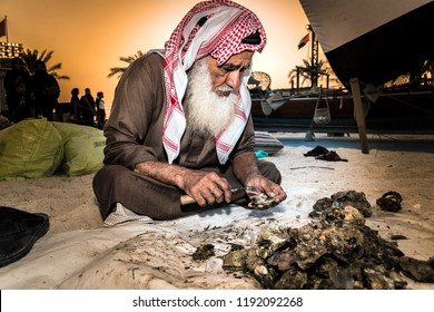 Craft pearl extraction of seashells. Where one of the sailors is taking out pearls, live display of one of the old handicrafts. Photography in Abu Dhabi, UAE, Sheikh Zayed Heritage Festival 17/01/2017
