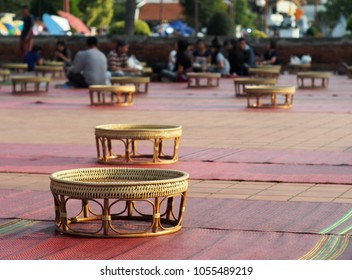 craft woven bamboo structure mini size cultural northern THAI traditional dining table contemporary utensils green eco-design furniture set on mattress for temple street market visitors outdoor