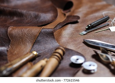 Crafting tools on natural cow leather in the tailoring workshop.