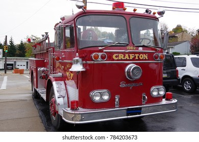 CRAFTON ,PA-NOVEMBER 5, 2017: Segrave Fire Apparatus LLC old red fire truck from 1960s as display of local fire department. Front view of truck with silver bell at Crafton, PA on November 5, 2017