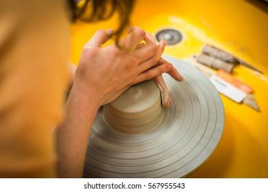 Craftsman artist pottery working