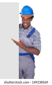 Craftsman Behind Placard Showing Thumb Up Sign Over White Background