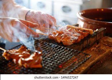 The craftsman is grilling yakitori Japanese food skewers chicken