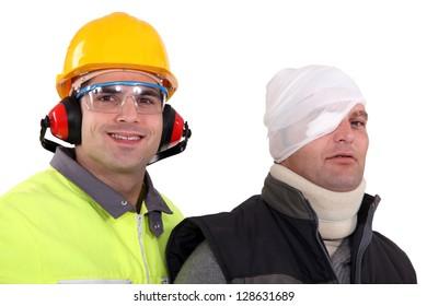 craftsman helping injured colleague
