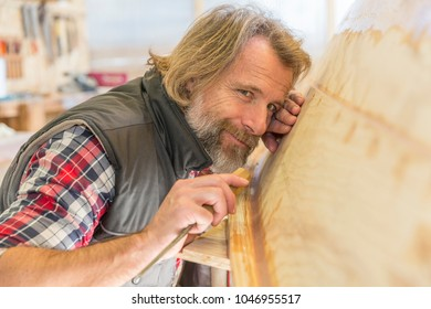Craftsman in his workshop making a boat