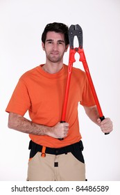 craftsman holding an enormous pair of pliers