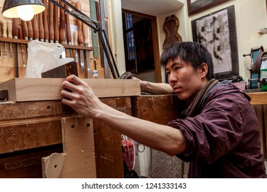 craftsman japaneese violinmaker began working on a new violin in his workshop