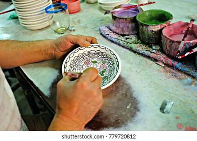 Craftsman painting crockery in Hebron, West Bank, Palestine