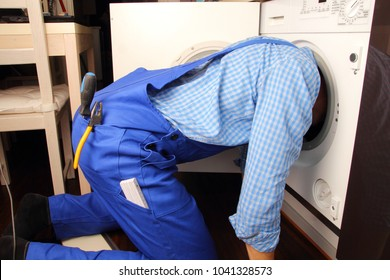 A Craftsman repairing washing machine