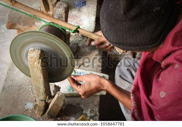 Craftsman Shaping Small Semiprecious Stone Piece Stock Photo