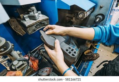 Craftsman shoemaker working