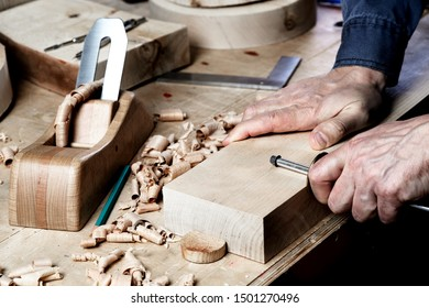 Craftsman skills concept. Woodworker in the shop. Carpenter making a pieces for the project. Joiner marks the workpiece