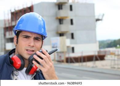 craftsman talking on a talkie walkie