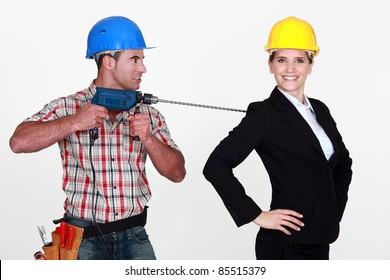 craftsman threatening his boss with a drill