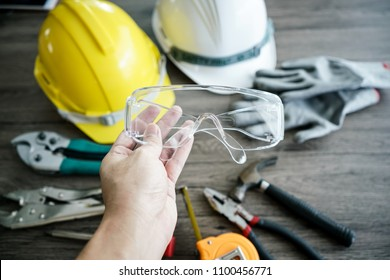 Craftsman tool, for man worker. Glasses safety in hand