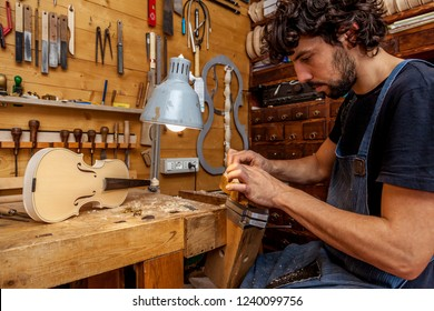 craftsman violinmaker began working on a new violin in his workshop