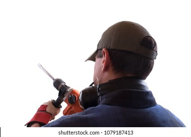 A craftsman working from behind with a demolition hammer (isolated)